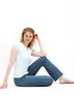 Girl sitting up straight on the floor Stock Photography