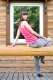 Girl sitting on a veranda Stock Photo