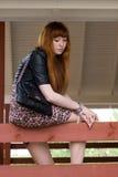 Girl sitting on a veranda Stock Image