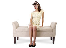 Girl Sitting and Waiting on Chaise Lounge. Stylish retro female sitting on a chaise lounge or sofa on white background stock photo