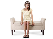 Girl Sitting and Waiting on Chaise Lounge. Stylish retro female sitting on a chaise lounge or sofa on white background stock images