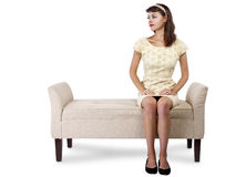 Girl Sitting and Waiting on Chaise Lounge. Stylish retro female sitting on a chaise lounge or sofa on white background royalty free stock photos