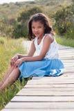 Girl sitting on walkway. Outdoors portrait stock image