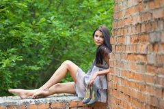 Girl sitting on wall Royalty Free Stock Photos