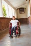Girl sitting in wheelchair in school corridor Royalty Free Stock Image