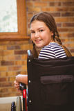 Girl sitting in wheelchair in school Royalty Free Stock Photos