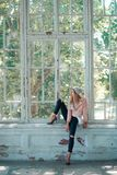 Girl sitting on window. Of an abandoned building Royalty Free Stock Image