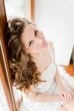 Girl  sitting on windowsill Royalty Free Stock Photography