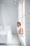 Girl sitting on the windowsill. top view Stock Photos