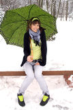 Girl sitting in winter park Stock Photos
