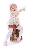 Girl sitting on a wooden Stock Images