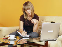 Girl sitting and working Royalty Free Stock Image