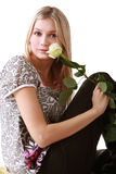 Girl sitting with yellow rose Royalty Free Stock Photo