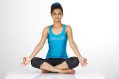 Girl sitting in yoga pose Royalty Free Stock Image