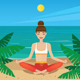 Girl sitting in yoga pose padmasana on the beach Royalty Free Stock Photography