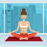 Girl sitting in yoga pose siddhasana near panoramic window Stock Image