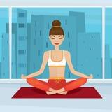 Girl sitting in yoga pose siddhasana near panoramic window Stock Image