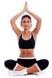 Girl sitting in yoga posture Stock Images