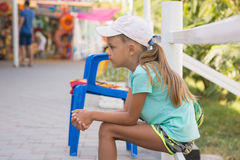 Girl six years sitting in street and waits Royalty Free Stock Image