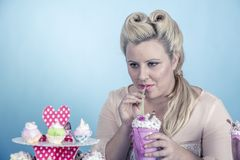 Girl with cupcakes. Is a girl from the sixties with cupcakes Stock Images