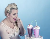 Girl with cupcakes. Is a girl from the sixties with cupcakes royalty free stock photos