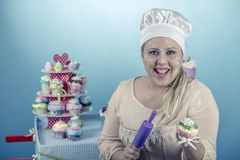 Girl with cupcakes. Is a girl from the sixties with cupcakes stock photography