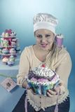 Girl with cupcakes. Is a girl from the sixties with cupcakes royalty free stock photo