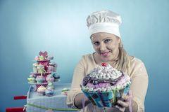 Girl with cupcakes Royalty Free Stock Photo