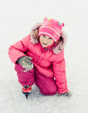 Girl in skate on the ice Royalty Free Stock Images