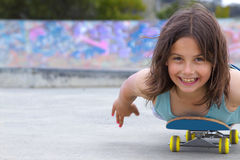 Girl on skateboard Stock Images