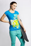 Girl with skateboard Stock Images