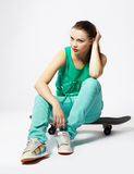 Girl with skateboard Stock Photography