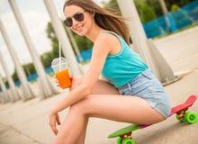 Girl on skateboard Stock Photo
