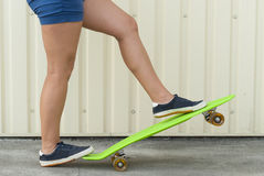 Girl with skateboard Royalty Free Stock Photos