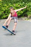 Girl with a skateboard Royalty Free Stock Photography
