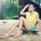 The girl on a skateboard Stock Images