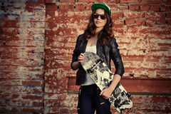 Girl with skateboard Stock Photos