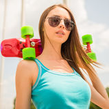 Girl on skateboard Stock Photos