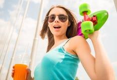 Girl on skateboard Stock Image