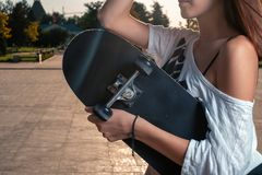 Girl with skateboard side view, copy space stock images
