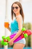 Girl on skateboard Royalty Free Stock Image