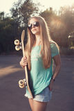 Girl with skateboard. Teen girl with a skateboard royalty free stock images