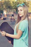 Girl with skateboard Royalty Free Stock Photo
