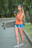 Girl on skateboard royalty free stock photography