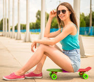 Girl on skateboard Stock Photography