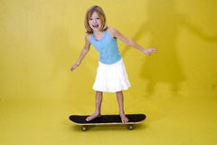 Girl on Skateboard2. Little girl on a skateboard stock photography