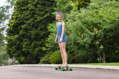 Girl Skateboarding Stock Images