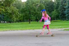 Girl skateboarding on natural background stock image