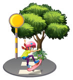 A girl skateboarding near the big tree Royalty Free Stock Photography