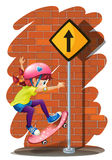 A girl skateboarding near the signboard Stock Image